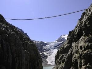 Suspension Trift Bridge with Trift Glacier in the background.