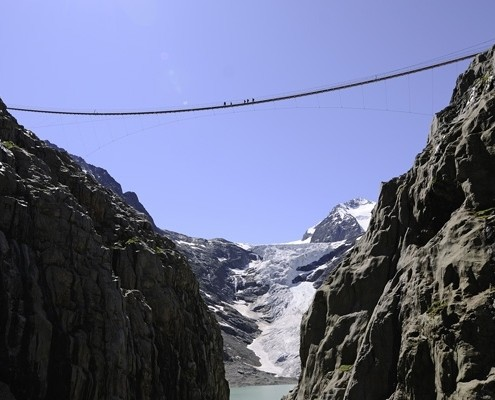 Suspension Trift Bridge with Trift Glacier in the background.