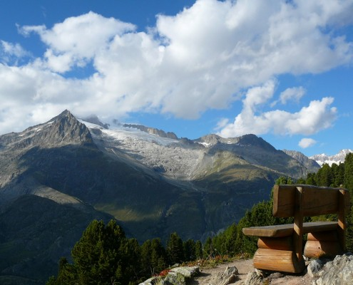 A swiss wooden bench in a viewpoint in Riederalp.