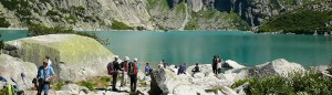 Tourists at the lake Gelmer, Hasli valley.