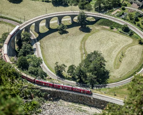 Bernina Express train on the round viaduct in Brusio.
