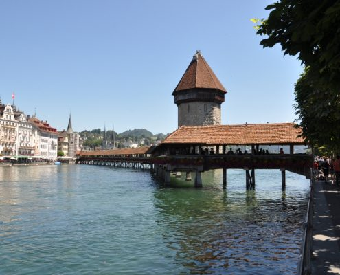 Kapellbrücke bridge and the Wasserturm tower on the Reuss river in Lucerne.