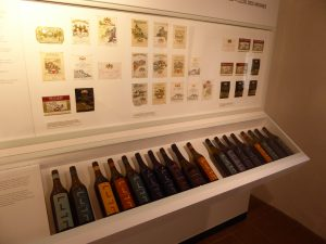 A collection of bottles and labels at the wine museum in Aigle.