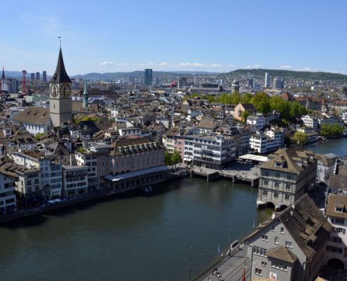 Zurich cityscape, Limmat river, town hall and St. Peter's Church.