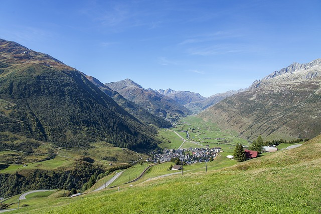 A view from above of Andermatt in the Urseren valley in Switzerland in summer.