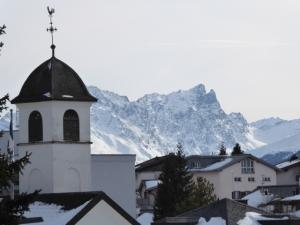 A view from Lenzerheide Vaz/Obervaz in Switzerland in winter. The bell tower of San Carlo church in Lenzerheide.