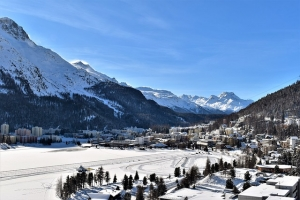 A view of St. Moritz and frozen Lake St. Moritz in the Upper Engadine valley in Switzerland in winter.